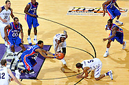 Jan 30, 2008; Manhattan, KS, USA; Kansas State Wildcats forward Bill Walker (12) reaches for a loose ball with Kansas Jayhawks guard Brandon Rush (25) in the second half at Bramlage Coliseum in Manhattan, KS. Kansas State upset the 2nd ranked Kansas Jayhawks 84-75. Mandatory Credit: Peter G. Aiken-US PRESSWIRE