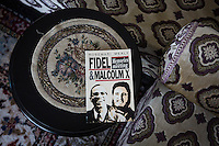 """CASABLANCA, MOROCCO - 14 MAY 2016: Rosemari Mealy's book """"Fidel & Malcolm X. Memories of a meeting"""", featuring pictures of the two leaders with Luqman Abdul-Hakeem (82), a close follower of Malcolm X that chauffeured the African American activist around and introduced him to Cuban leader  Fidel Castro in September 1960, is here in Mr Hakeem's home in Sidi Maarouf, a district of Casablanca, Morocco, on May 14th 2016.<br /> <br /> Born in Cleveland, OH, in 1934, Luqman Abdul-Hakeem was raised in Flushing, Queens, and then moved to Bayside, where he graduated in 1952. He attended the New York Technical University for a few months before enrolling in the Navy, where he stayed for two years. Though he had asked for ship duty, he ended up in Springfield, Mass., and Glennclose, Ill. He moved to Brooklyn when his hitch was done and by 1966 was studying jujitsu and aikido. He met Malcolm X during one of his sermons on 116th street in Harlem, New York, in the late 50's. In 1985, Mr. Hakeem decided to move to Marocco because America wasn't a country where he wanted to raise hois children. He has been teaching aikido in the two dojos he owns in Casablanca until 2014, when he underwent a surgery."""