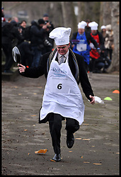 Stephen Lloyd Lib Dem takes part in the MP's and Lords race against political Journalist in the Rehab Parliamentary Pancake Shrove Tuesday race a charity event which sees MPs and Lords joined by media types in a race to the finish. Victoria Tower Gardens, Westminster, Tuesday February 12, 2013. Photo By Andrew Parsons / i-Images