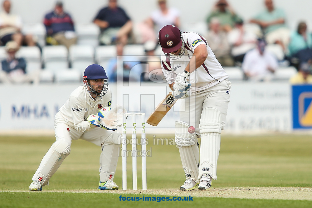 Richard Levi of Northamptonshire (right) defends during the LV County Championship Div Two match at the County Ground, Northampton<br /> Picture by Andy Kearns/Focus Images Ltd 0781 864 4264<br /> 08/06/2015