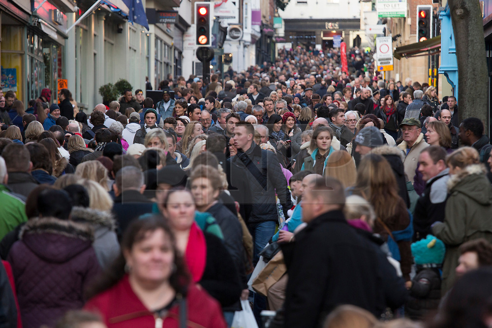 "© Licensed to London News Pictures. 7/12/2013. Lincoln, UK. Lincoln City Centre was packed with Christmas shoppers this weekend. Pictured, tightly packed shoppers struggle to make their way up the High Street in Lincoln. Thousands of shoppers filled the City Centre and stewards were called in to direct people up the narrow ""Steep Hill"" towards the upper area of Lincoln near the Cathedral. Photo credit : Dave Warren/LNP"