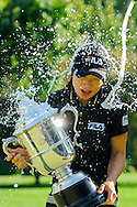 Eun-Hee Ji takes a champagne bath after winning the U.S. Women's Open golf championship at the Saucon Valley Country Club in Bethlehem, Pennsylvania.