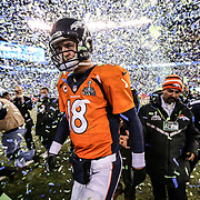 Denver Broncos quarterback Peyton Manning (18) walks off the field after losing to the Seattle Seahawks in Super Bowl XLVIII at Metlife Stadium on Sunday, Feb. 2, 2014, in East Rutherford, N.J. (AP Photo/Ben Liebenberg)