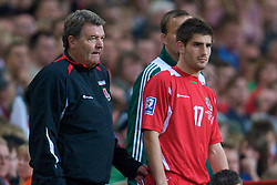 CARDIFF, WALES - Saturday, October 11, 2008: Wales' manager John Toshack prepares substitute Ched Evans during the 2010 FIFA World Cup South Africa Qualifying Group 4 match against Liechtenstein at the Millennium Stadium. (Photo by David Rawcliffe/Propaganda)