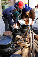 "Women prepare a traditional beans soup for the traditional Celtic carnival ""Caretos"" in the village of Lazarim, central Portugal on February 17, 2015. PAULO CUNHA /4SEE"