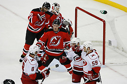 Apr 15, 2009; Newark, NJ, USA; Carolina Hurricanes center Matt Cullen (8), Carolina Hurricanes left wing Ray Whitney (13) and Carolina Hurricanes defenseman Frantisek Kaberle (5) celebrate Whitney's goal during the third period of game one of the eastern conference quarterfinals of the 2009 Stanley Cup playoffs at the Prudential Center. The Devils defeated the Hurricanes 4-1 to take a 1-0 series lead.