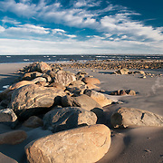Rocks and boulders placed by the sea on the southern end of Plum Island Massachusetts