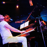 January 8, 2012 - Manhattan, NY : Andrew W.K. (piano, vocals) performs with the Calder Quartet (only violinist Andrew Bulbrook can be seen -- reflected in side of piano) at Le Poisson Rouge in Manhattan on Sunday evening.  CREDIT: Karsten Moran for The New York Times