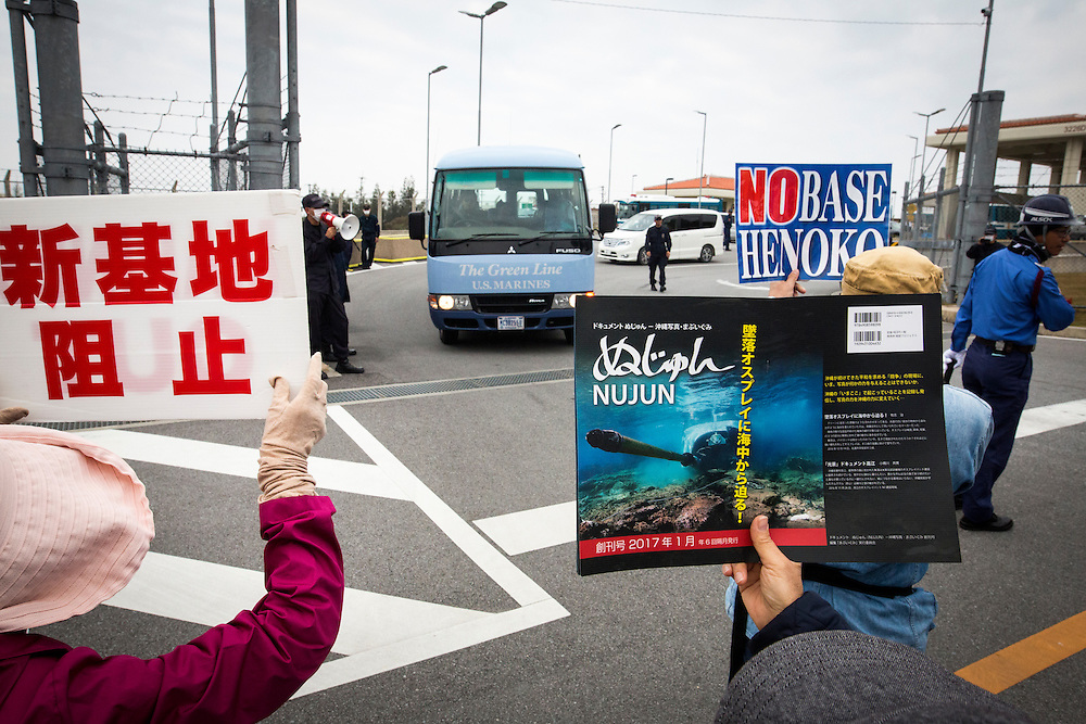 OKINAWA, JAPAN - FEBRUARY 1 : Anti U.S. Base protesters hold placards and block the service of Marines outside of the U.S Marine Camp Schwab gate to protest against the construction of the new U.S Marine Airbase in Nago, Okinawa, Japan on Wednesday, February 1, 2017. Okinawa Gov. Takeshi Onaga arrived in the United States on Tuesday, aiming to convey to President Donald Trump's administration local opposition to a plan to relocate a U.S. airbase within the southern island prefecture. (Photo by Richard Atrero de Guzman/NURPhoto)