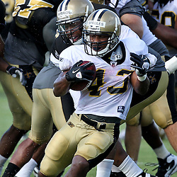 August 9, 2011; Metairie, LA, USA; New Orleans Saints running back Darren Sproles is grabbed by cornerback Trumaine McBride (37) during training camp practice at the New Orleans Saints practice facility. Mandatory Credit: Derick E. Hingle