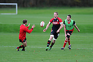 Bradley Davies © passes to Leigh Halfpenny. Wales rugby team training at the Vale, Hensol, near Cardiff in South Wales on Tuesday 13th November 2012.  pic by Andrew Orchard, Andrew Orchard sports photography,