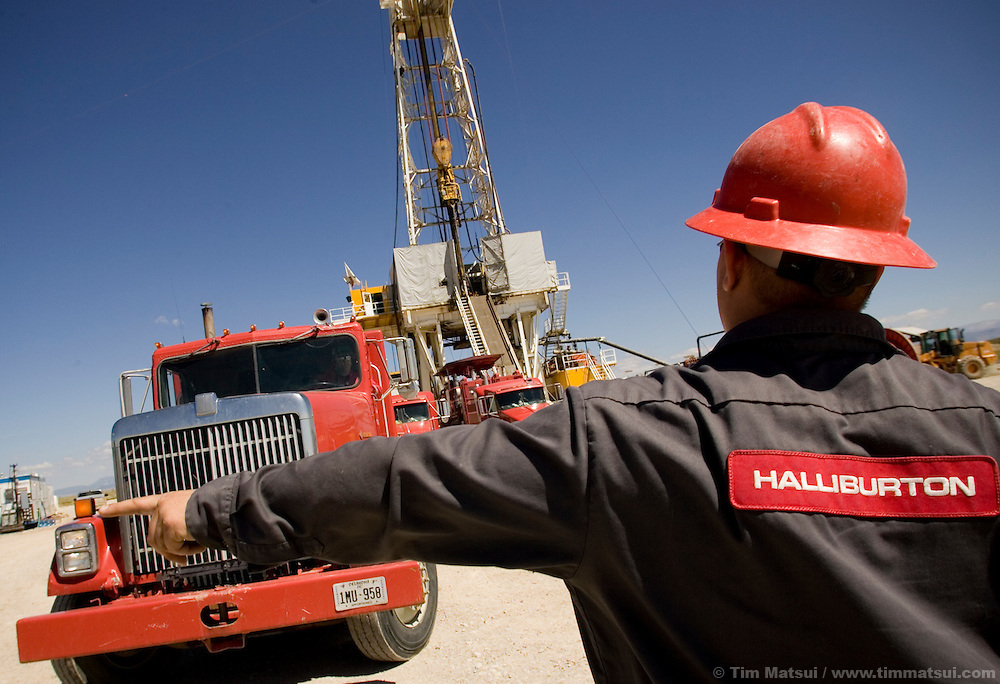 "Halliburton workers position a truck, at a natural gas drilling platform near Pinedale, Wyoming, where hydrofracturing (""fracking"") for gas is creating a boom economy."