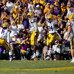 Oct 12, 2013; Baton Rouge, LA, USA; LSU Tigers defensive end Jermauria Rasco (59) celebrates with teammates following a defensive stop against the Florida Gators during the first half of a game at Tiger Stadium. Mandatory Credit: Derick E. Hingle-USA TODAY Sports