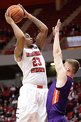 15 January 2016: Adam Wing(12) defends a shot by Deontae Hawkins(23) during the Illinois State Redbirds v Evansville Purple Aces at Redbird Arena in Normal Illinois (Photo by Alan Look)
