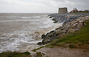 Strong winds and large waves batter the coastline at East Lane, Bawdsey, Suffolk, England