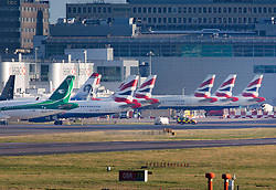 © Licensed to London News Pictures. 20/12/2018. London, UK. Aircraft are seen parked at gates at Gatwick airport at first light. Flights have been cancelled and thousands of passengers have been delayed after the airport closed due to two drones being spotted nearby. Photo credit: Peter Macdiarmid/LNP