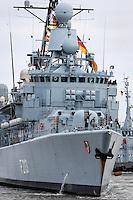 DEU, Deutschland, Wilhelmshaven, 24. Maerz 2016: Die  Fregatte F213 &quot;Augsburg&quot; der Bundesmarine wird im Marinehafen von Wilhelmshaven  an ihren Liegeplatz geschleppt. Das Schiff kehrt von einer mehrmonatigen Reise aus dem Persischen Golf zurueck, wo es den franzoesischen Flugzeugtraeger &quot;Charles de Gaulle&quot; bei der Operation &quot;Counter Daesh MAR&quot; im Kampf gegen den so genannten IS in Syrien und im Irak unterstuetzt hat. | DEU, Germany, Wilhelmshaven, March 24, 2016: The frigate F213 &quot;Augsburg&quot; of the German Navy is pictured at the Navy port of Wilhelmshaven. The vessel returns from a mission in the Persian Gulf where it supported the French aircraft carrier &quot;Charles de Gaulle&quot; in the Operation &quot;Counter Daesh MAR&quot; against the so called IS in Syria and Iraq |<br /> <br /> [ CREDIT: www.fockestrangmann.de - MWSt./VAT/TVA  7 % - Focke Strangmann Fotos - Rossbachstr. 46 - 28201 B r e m e n - Germany - Tel.  +49.163.2513863  - ich@fockestrangmann.de - Bank: S p a r k a s s e B r e m e n  BLZ: 29150101 Konto: 10886646 IBAN: DE05 2905 0101 0010 8866 46 00 BIC: SBREDE22 Stnr. 602730314, FA Bremen, VAT DE225275020 ---  ] <br /> <br /> [#0,26,121#]