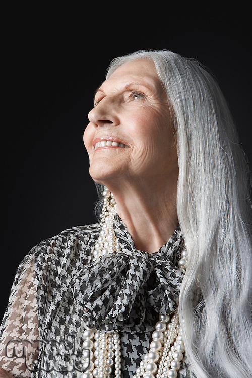 Senior Woman with Long Hair looking up