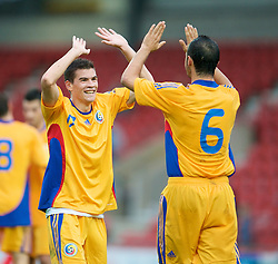 WREXHAM, WALES - Wednesday, August 20, 2008: Romania's Razvan Ochirosii (L) and Alexandru Todose celebrate their 1-0 victory over Wales during the UEFA Under 21 European Championship Qualifying Group 10 match at the Racecourse Ground. (Photo by David Rawcliffe/Propaganda)