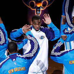 Mar 22, 2010; New Orleans, LA, USA; New Orleans Hornets guard Marcus Thornton is greeted by teammate during introductions prior to tip off against the Dallas Mavericks at the New Orleans Arena. Mandatory Credit: Derick E. Hingle-US PRESSWIRE
