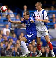 Photo: Daniel Hambury.<br />Chelsea v Portsmouth. The Barclays Premiership. 21/10/2006.<br />Chelsea's Arjen Robben and Portsmouth's Matthew Taylor battle.