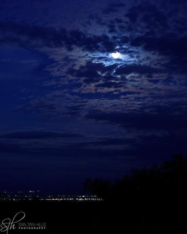 Full Moon, lightly covered by clouds, over San Tan Valley.  Seen from San Tan Regional Park, Queen Creek, AZ