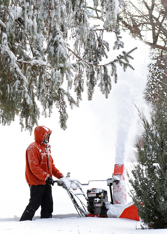 (Boston, MA - 1/28/15) Luis Fernandes of M7 Maintenance clears snow from in front of Second Church in Dorchester in Codman Square, Wednesday, January 28, 2015. Staff photo by Angela Rowlings.