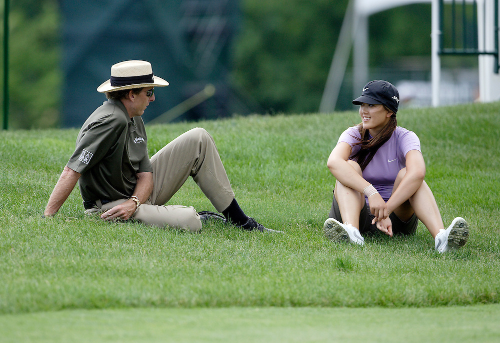 HAVRE DE GRACE, MD, June 5, 2007:  Michelle Wie and coach David Leadbetter talk two days before the start of the LPGA Championship in Havre De Grace, MD on June 5, 2007.  (Photo by Todd Bigelow/Aurora)