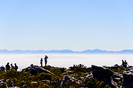 Tourists at the top of the Table Mountain Aerial Tramway overlooking Capetown, South Africa. ©Brett Wilhelm