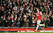 Arsenal's Robin Van Persie, celebrates after scoring a goal against Barcelona during a Champions League, round of 16, first leg soccer match at Arsenal's Emirates stadium in London, Wednesday, Feb. 16, 2011.