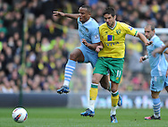 Picture by Andrew Timms/Focus Images Ltd. 07917 236526.14/04/12.Andrew Surman of Norwich City and Vincent Kompany of Manchester City during the Barclays Premier League match at Carrow Road stadium, Norwich.