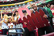 Washington Redskins' fans cheer as the Redskins defeat the Arizona Cardinals 22-21 at FedEx Field in Washington on September 18, 2011.  UPI/Kevin Dietsch