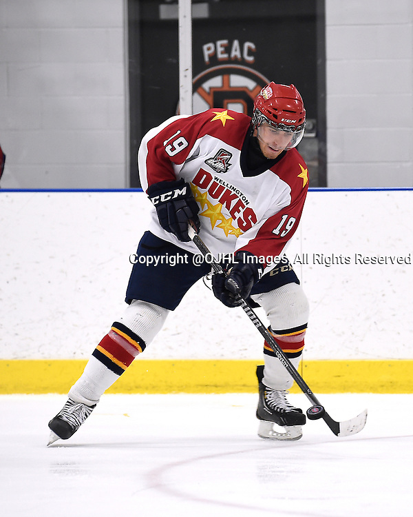 TORONTO, ON - Sep 20, 2014 : Ontario Junior Hockey League game action between Wellington and Toronto, Joe McKeown #19 of the Wellington Dukes Hockey Club passes the puck during the third period.<br /> (Photo by Andy Corneau / OJHL Images)