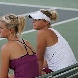 Sisters, Chelsey Gullickson (left) and Carly Gullickson (right) sit on their bench after losing the finals of doubles competition at the AT&T$25,000 Challenger USTA Pro Women's Tennis Circuit Tournament played on March 30, 2008 at Oak Knoll Country Club in Hammond, LA. Raquel Kops-Jones and Abigail Spears defeated sisters Chelsey Gullickson and Carly Gullickson in two sets 7-5, 6-4 to when the doubles title at the AT&T 25K Challenger.