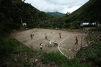 Kids play soccer in a coca-growing region in a remote area of the southern Colombian state of Nariño, on Thursday, June 21, 2007. (Photo/Scott Dalton)