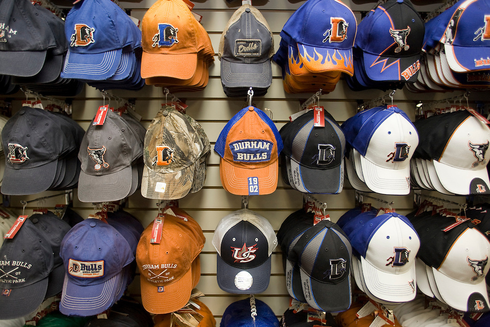 A small sample of the many varieties of Durham Bulls headgearavailableat the spacioussouvenirshop.