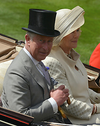 © Licensed to London News Pictures. 19/06/2012. Ascot, UK  Their Royal Highnesses The Duke and Duchess of Cornwall. The royal procession enter the parade ring on Day one at Royal Ascot 19 June 2012. Royal Ascot has established itself as a national institution and the centrepiece of the British social calendar as well as being a stage for the best racehorses in the world.. Photo credit : Stephen Simpson/LNP