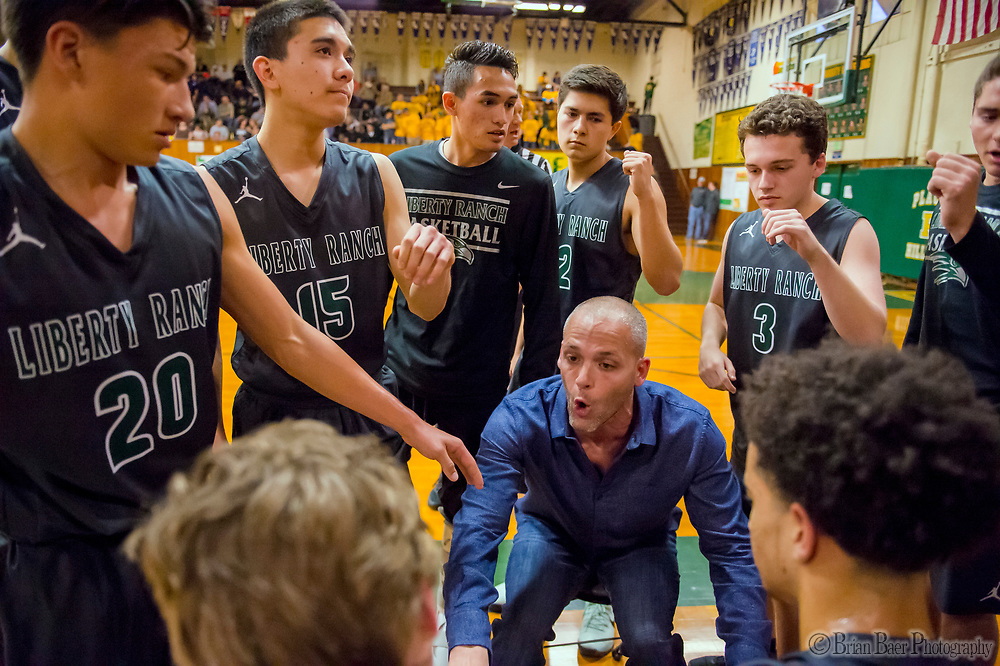Liberty Ranch Hawks head coach Josh Williams talks to his team during a timeout as the Placer Hillman host the Liberty Ranch Hawks Varsity basketball team in the DIV NorCal boys quarterfinal, Saturday Mar 10, 2018.  <br /> photo by Brian Baer