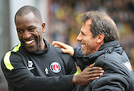 Picture by David Horn/Focus Images Ltd +44 7545 970036<br /> 14/09/2013<br /> Gianfranco Zola Manager of Watford (right) and Chris Powell Manager (left) of Charlton Athletic embrace before the Sky Bet Championship match at Vicarage Road, Watford.