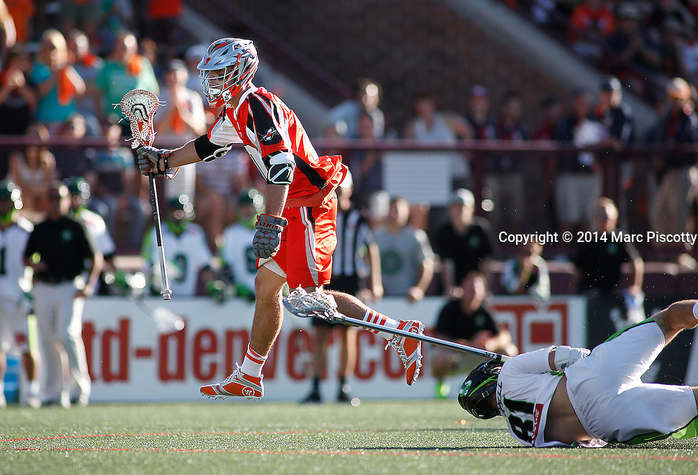 SHOT 8/16/14 5:47:30 PM - The Denver Outlaws Jeremy Sieverts #20 jumps over the outstretched reach of the New York Lizards Kyle Hartzell #81 during their MLL Semifinals matchup at Peter Barton Lacrosse Stadium on the University of Denver campus in Denver, Co. Saturday. The Denver Outlaws won the game 14-13 to advance. (Photo by Marc Piscotty / © 2014)