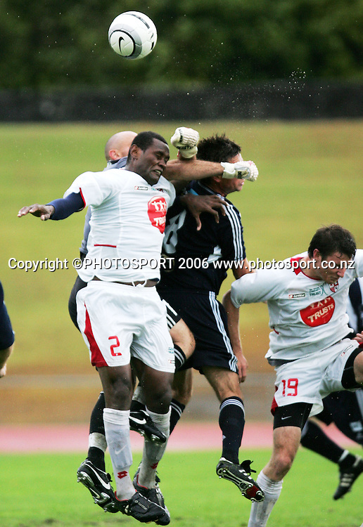 Waitakere United's George Suri competes for the ball with Auckland City goalkeeper Ross Nicholson during the NZFC Round 21 soccer match between Waitakere United and Auckland City at Trusts Stadium, Waitakere on Sunday 26 March 2006. Auckland City won the match 2-1. Photo: Tim Hales/PHOTOSPORT