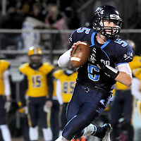 Austin Schoenleber looks to pass against Cape Fear Friday November 21, 2014 at Hoggard High School in Wilmington, N.C. (Jason A. Frizzelle)