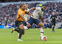 Football - 2019 / 2020 Premier League - Tottenham Hotspur vs. Wolverhampton Wanderers<br /> <br /> Adama Traore (Wolverhampton Wanderers) and Japhet Tanganga (Tottenham FC)  tussle for the ball shortly before the Wolves player injures his shoulder  at The Tottenham Hotspur Stadium.<br /> <br /> COLORSPORT/DANIEL BEARHAM