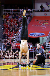 11 February 2017: Christian Stoinev an ISU alum, former member of the Gamma Phi Circus and once a finalist on Americas Got Talent performs with his dog Scooby during a College MVC (Missouri Valley conference) mens basketball game between the Bradley Braves and Illinois State Redbirds in  Redbird Arena, Normal IL