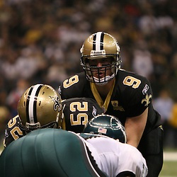 13 January 2007: New Orleans Saints quarterback Drew Brees (9) under center during a 27-24 win by the New Orleans Saints over the Philadelphia Eagles in the NFC Divisional round playoff game at the Louisiana Superdome in New Orleans, LA. The win advanced the New Orleans Saints to the NFC Championship game for the first time in the franchise's history.