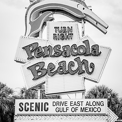 Landmark Pensacola Beach sign black and white photo. The famous sign is along the Gulf Breeze Parkway in Gulf Breeze Florida. Photo is vertical and high resolution. Copyright ⓒ 2018 Paul Velgos with All Rights Reserved.