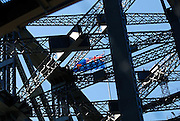 The State Flag of New South Wales flying atop the Sydney Harbour Bridge. Sydney, Australia