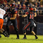 10 November 2018: San Diego State Aztecs quarterback Christian Chapman (10) drops back to pass in the first quarter against the UNLV Rebels. The Aztecs lost 27-24 to UNLV Saturday night at SDCCU Stadium falling a game behind Fresno State in the conference standings.