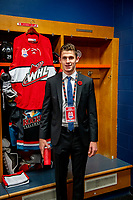 KAMLOOPS, CANADA - NOVEMBER 5: Nolan Foote #29 of Team WHL (Kelowna Rockets) stands in front of his locker in the dressing room against the Team Russia on November 5, 2018 at Sandman Centre in Kamloops, British Columbia, Canada.  (Photo by Marissa Baecker/Shoot the Breeze)