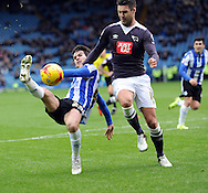 Keiran Lee of Sheffield Wednesday battles with Jason Shackell of Derby County during the Sky Bet Championship match at Hillsborough, Sheffield<br /> Picture by Graham Crowther/Focus Images Ltd +44 7763 140036<br /> 06/12/2015